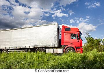 camion rosso, su, autostrada