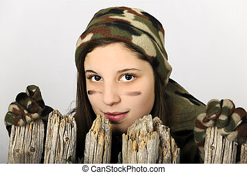 Camo Girl Behind a Fence - Close-up of an attractive young...