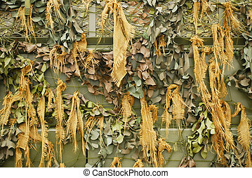 camouflage net - background of camouflage netting covering a...