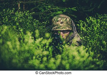 Camouflaged Poacher at Hunt - Camouflaged Poacher with Rifle...