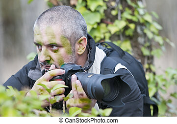 Camouflaged war photographer.