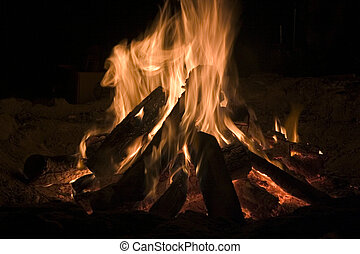 Camp Fire - A roaring camp fire in the dark.