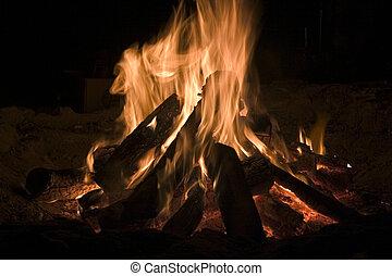 Camp Fire - A roaring camp fire in the dark.