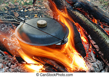 camp fire and pot