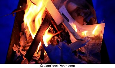 Camp fire burning at night in winter