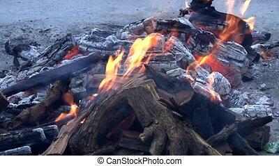 Camp fire in the wind
