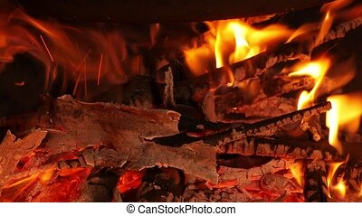 Camp fire under a pot - Fire for cooking in a large pot