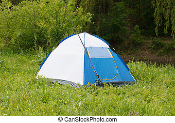 Camp tent and fishing rod on outdoor