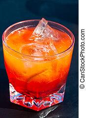 campari orange - a glass of campari and orange with an ...
