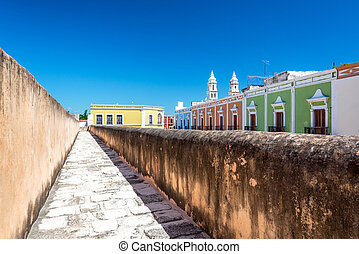 Colorful colonial buildings in Campeche, Mexico as seen from atop the defensive wall