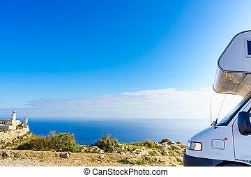 Camper at Mesa Roldan lighthouse, Spain