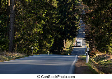 Camper car on a forest road