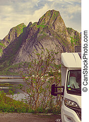 Camper car on fjord, Lofoten Norway