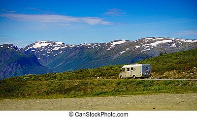 Camper car on road in norwegian mountains