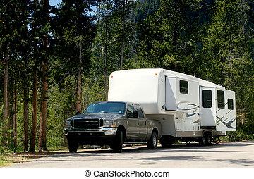 camper trailer in yellowstone - a camper / trailer in...