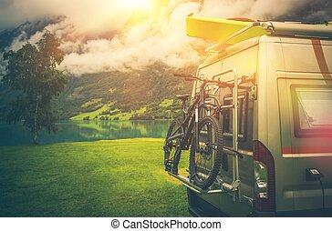 Camper Trip Adventures. Modern Camper Van Motorcoach with Bike and Kayak.