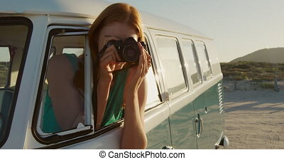 Camper van road trip by the sea - Front view close up of a ...