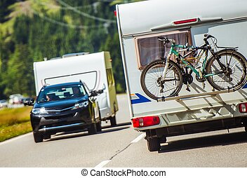 Campers Peak Season. Travel Trailers and Campers on the...