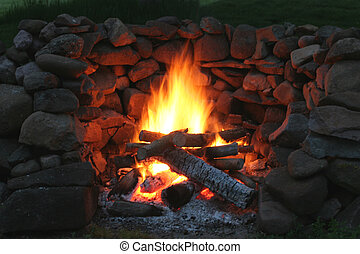 Campfire - A large stone fireplace style back yard fire pit