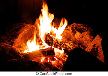 Campfire - A warm campfire with a black background.
