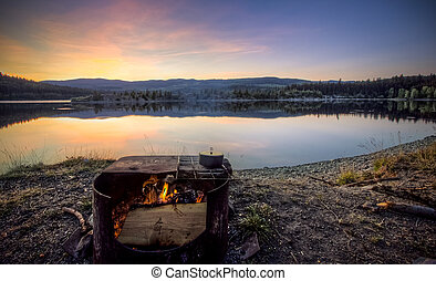 Campfire at a scenic Campsite in the Mountains
