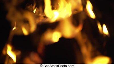 Campfire burning at night, blur, abstract