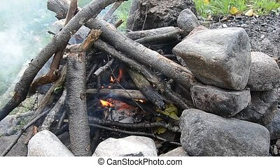 Campfire. - Campfire burning wood with flames and smoke.