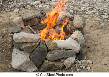 Campfire  - Classic campfire burning in a rock ring.