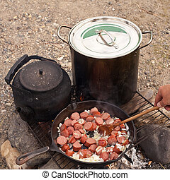 Campfire Cooking - Cooking Dinner on campfire in cast iron...