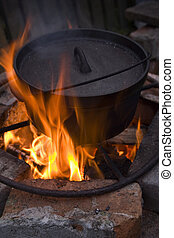 Campfire Cooking - Cooking in a Dutch Oven over a fire