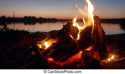 Campfire during a beautiful Sunset on a Beach.