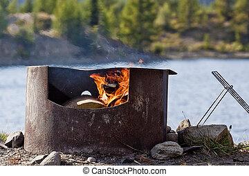 Campfire on Mountain Lake