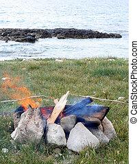 Campfire on the beach grass