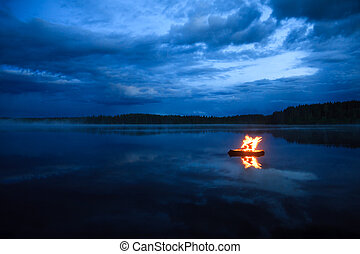 Campfire on the lake at night