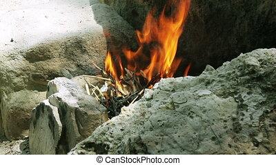 Campfire on the sandy sea beach