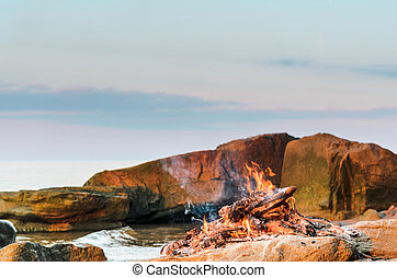 Campfire on the seashore