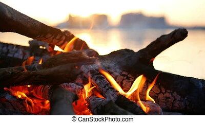 Campfire sunset river - Campfire during a beautiful sunset...