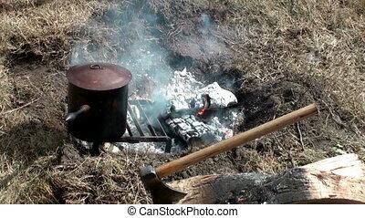 Campfire with axe - Campsite campfire with axe