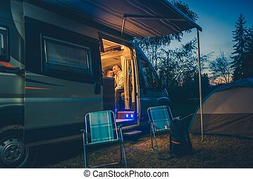 Campground RV and Tent Camping. Evening Relaxing on the Campsite.