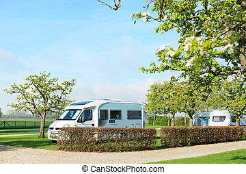 Campground with camper and caravan - Campground with mobile...