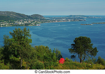 Camping above Aalesund, Norway with a view on the surrounding skerry landscape