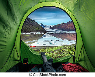 Camping at glacier with cold lake in Iceland