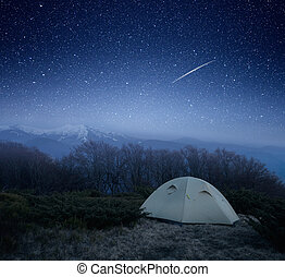 Camping at night in the mountains - Tourist tent under the...