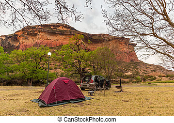 Camping beside scenic cliffs and landscape at the majestic Golden Gate Highlands National Park, famous travel destination in South Africa. Summer vacations and adventures.