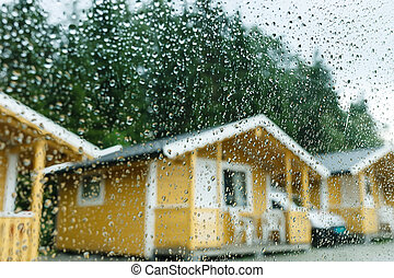 Camping cabins in heavy rain - view through the window