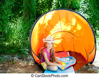 Camping children girl with hat in forest tent outdoor