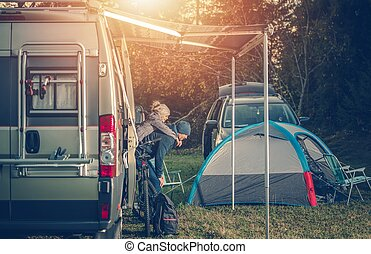 Camping Family Time. Father Playing with His Daughter Around...