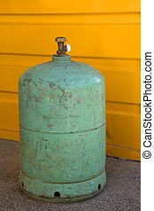 Camping gas container, green over yellow