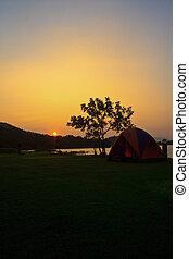 camping ground and sunset at lake
