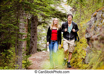 Camping Hiking Man and Woman - A happy man and woman hiking ...